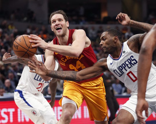 Indiana Pacers forward Bojan Bogdanovic (44) is fouled by LA Clippers guard Sindarius Thornwell (0) in the first half of their game at Bankers Life Fieldhouse on Thursday, Feb. 7, 2019.