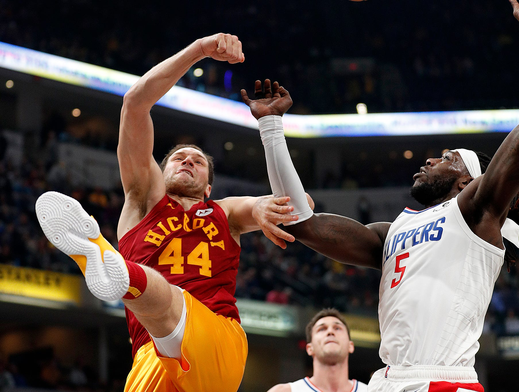 Indiana Pacers forward Bojan Bogdanovic (44) is fouled by LA Clippers forward Montrezl Harrell (5) in the first half of their game at Bankers Life Fieldhouse on Thursday, Feb. 7, 2019.