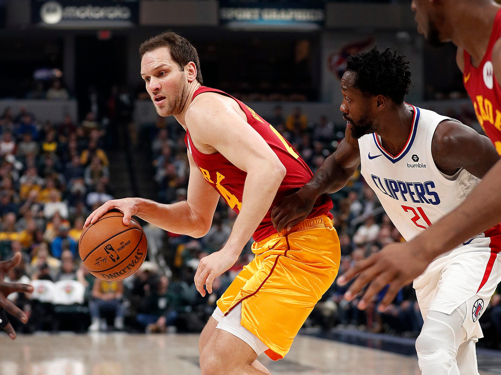 Indiana Pacers forward Bojan Bogdanovic (44) dribbles around LA Clippers guard Patrick Beverley (21) in the first half of their game at Bankers Life Fieldhouse on Thursday, Feb. 7, 2019.