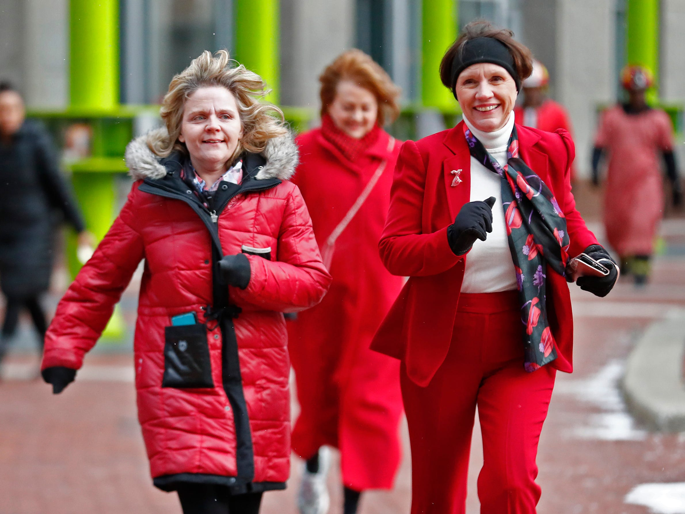 Angie Dyskey Christie Artuso, with the Richard Roudebush Medical Center, join a sea of red as they dash around Monument Circle for the Red Dress Dash, Friday, Feb. 8, 2019.  The American Heart Association put on the seventh annual event to support women's heart health.  The event raises awareness for the American Heart Association's Go Red For Women movement.  Heart disease is the leading cause of death among women.