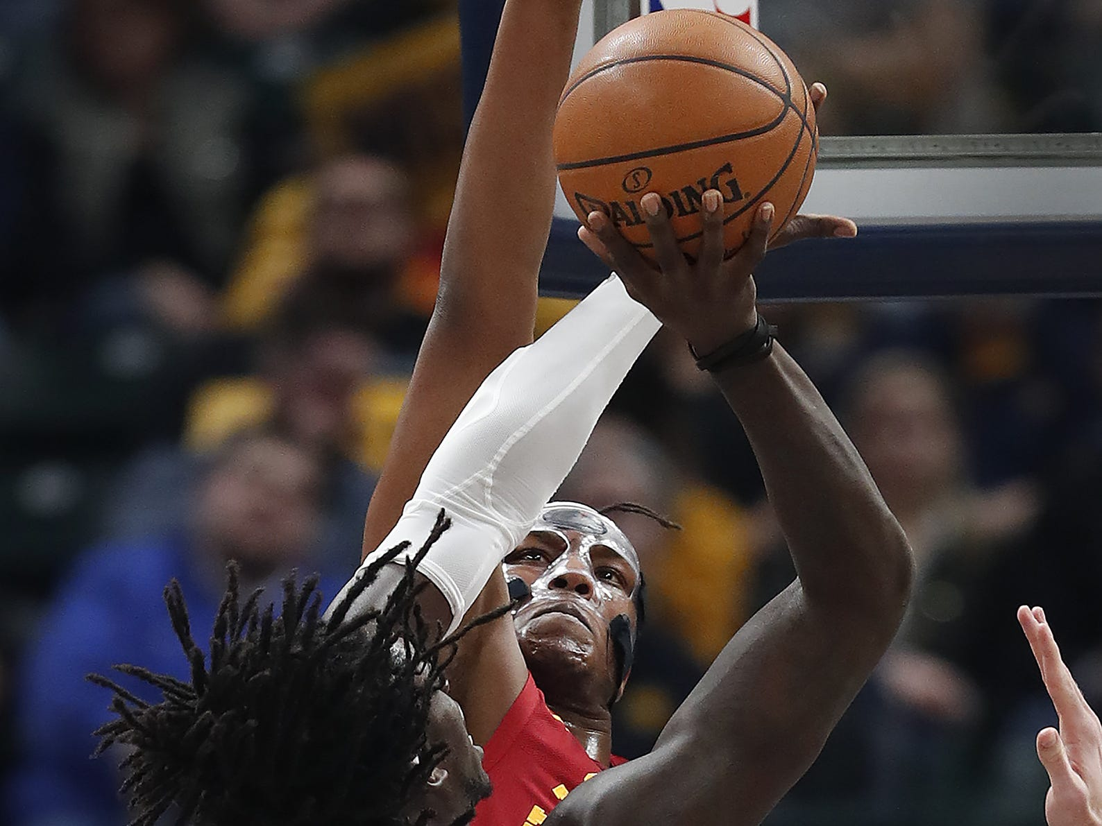 Indiana Pacers center Myles Turner (33) defends the shot by LA Clippers forward Johnathan Motley (15) in the first half of their game at Bankers Life Fieldhouse on Thursday, Feb. 7, 2019.
