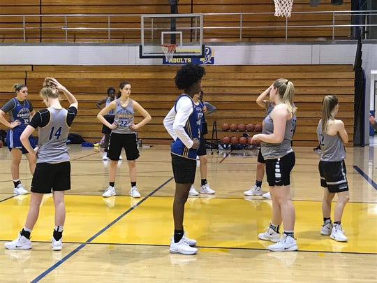 Homestead freshman Ayanna Patterson (center) at practice last week.