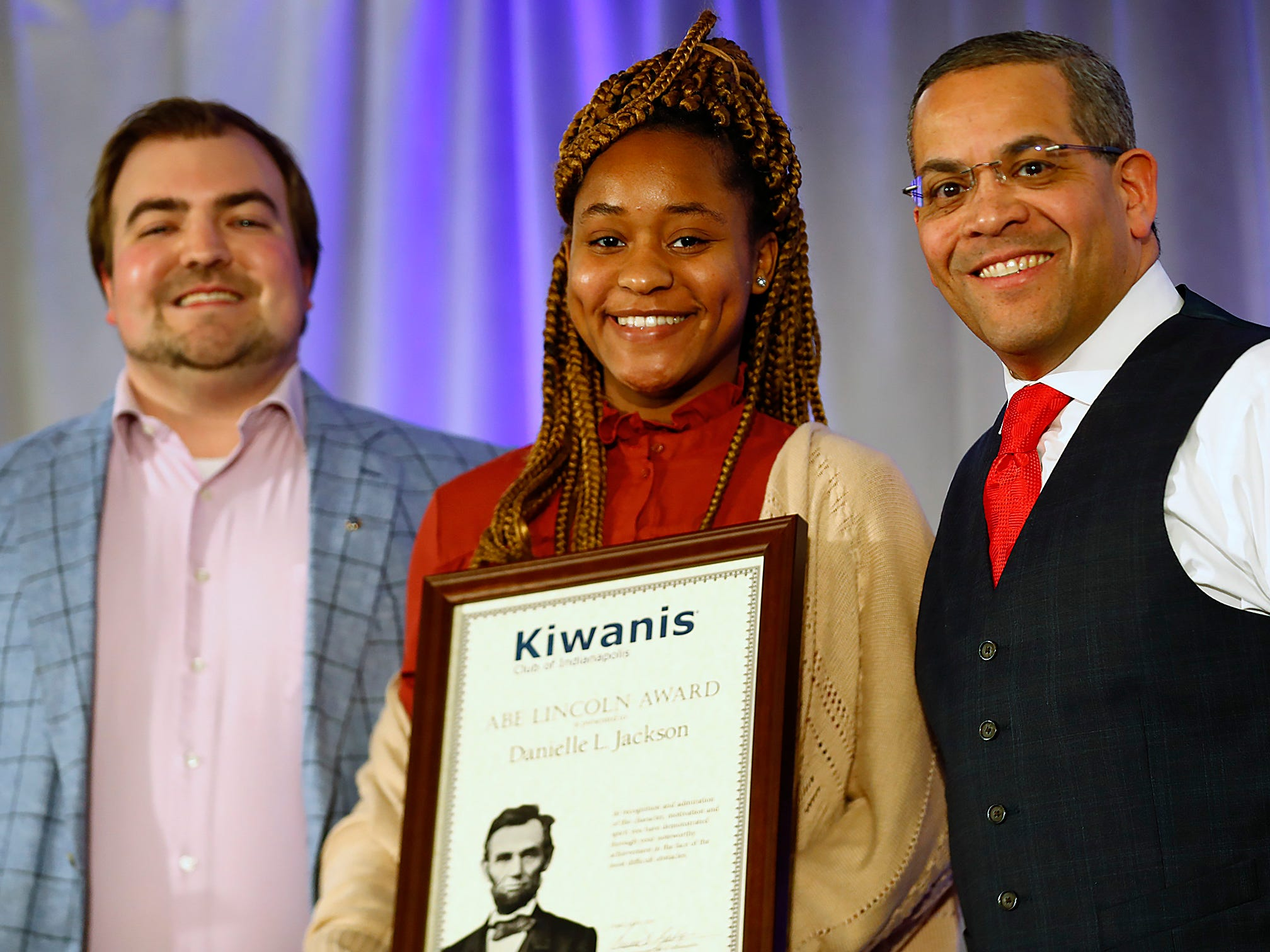 Pike High School student Danielle Jackson, center, poses with Alex Sventeckis, left, and Rafael Sanchez after receiving her 2nd Place Scholarship award at the 44th Annual Abe Lincoln Awards Program, Friday, Feb. 8, 2019. The Kiwanis Club of Indianapolis program was held at Ivy Tech Community College.  20 high school student were honored at the annual event which celebrates overcoming adversity in life to succeed. Four of the 20 students received scholarships.