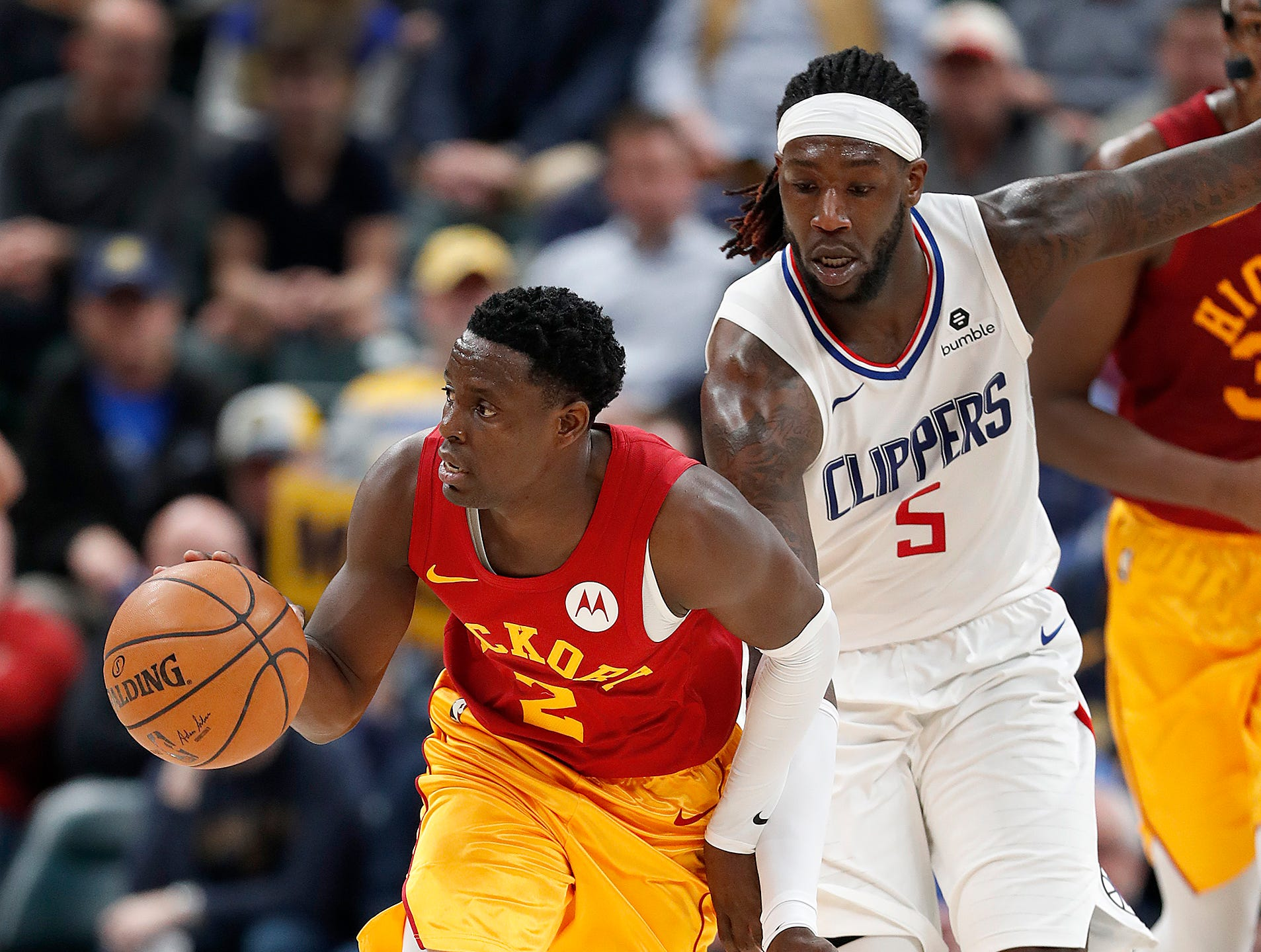Indiana Pacers guard Darren Collison (2) starts the fast break by LA Clippers forward Montrezl Harrell (5) in the second half of their game at Bankers Life Fieldhouse on Thursday, Feb. 7, 2019.
