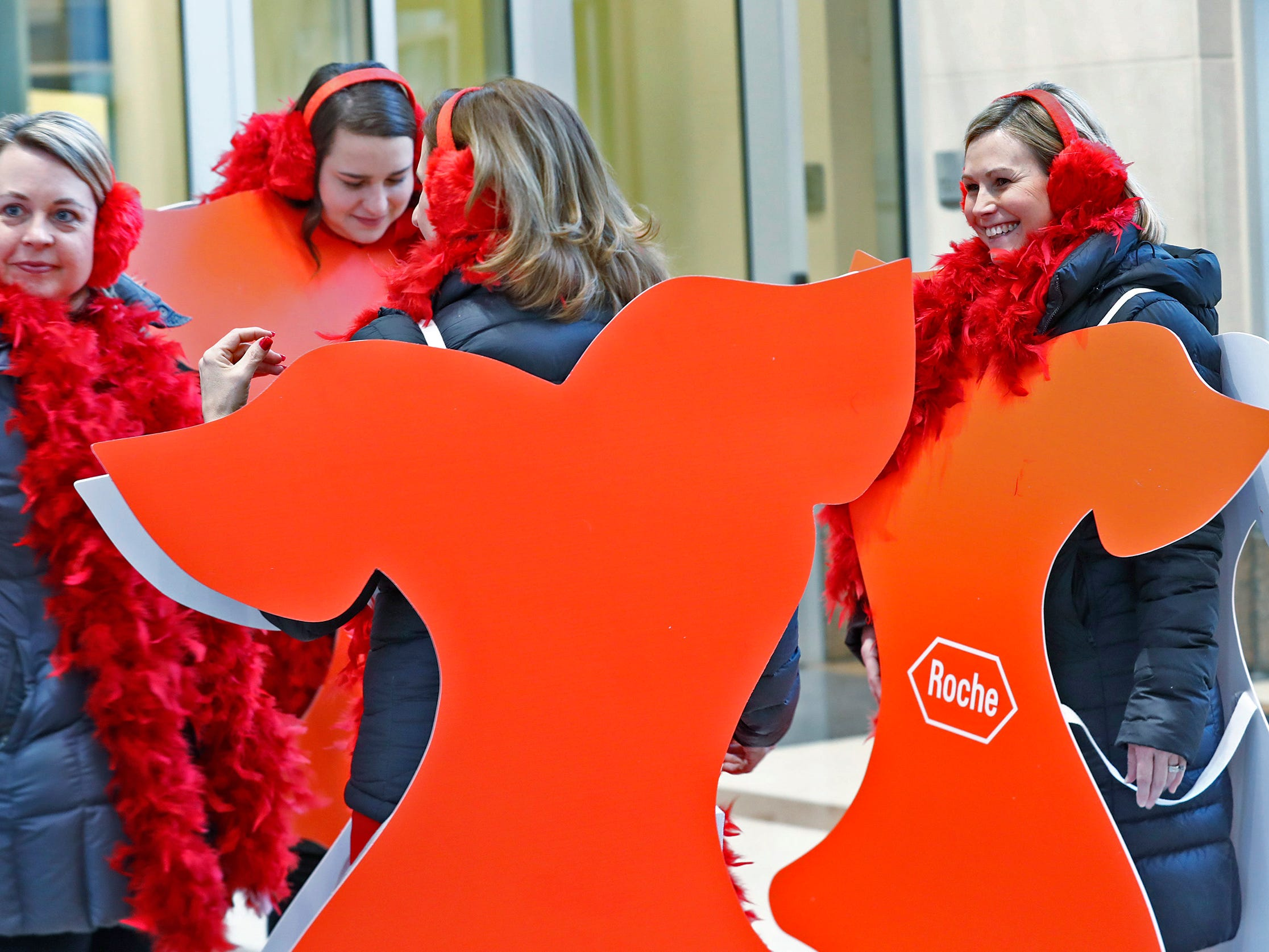 Courtney Sweeney, right, with Roche, laughs with her friends as they wear cut out red dresses before they walk around Monument Circle for the Red Dress Dash, Friday, Feb. 8, 2019.  The American Heart Association put on the seventh annual event to support women's heart health.  The event raises awareness for the American Heart Association's Go Red For Women movement.  Heart disease is the leading cause of death among women.