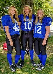 Mooresville's Elise Scaggs (middle) with her two sisters. The trio plays with the Indiana Girls Tackle Football League.