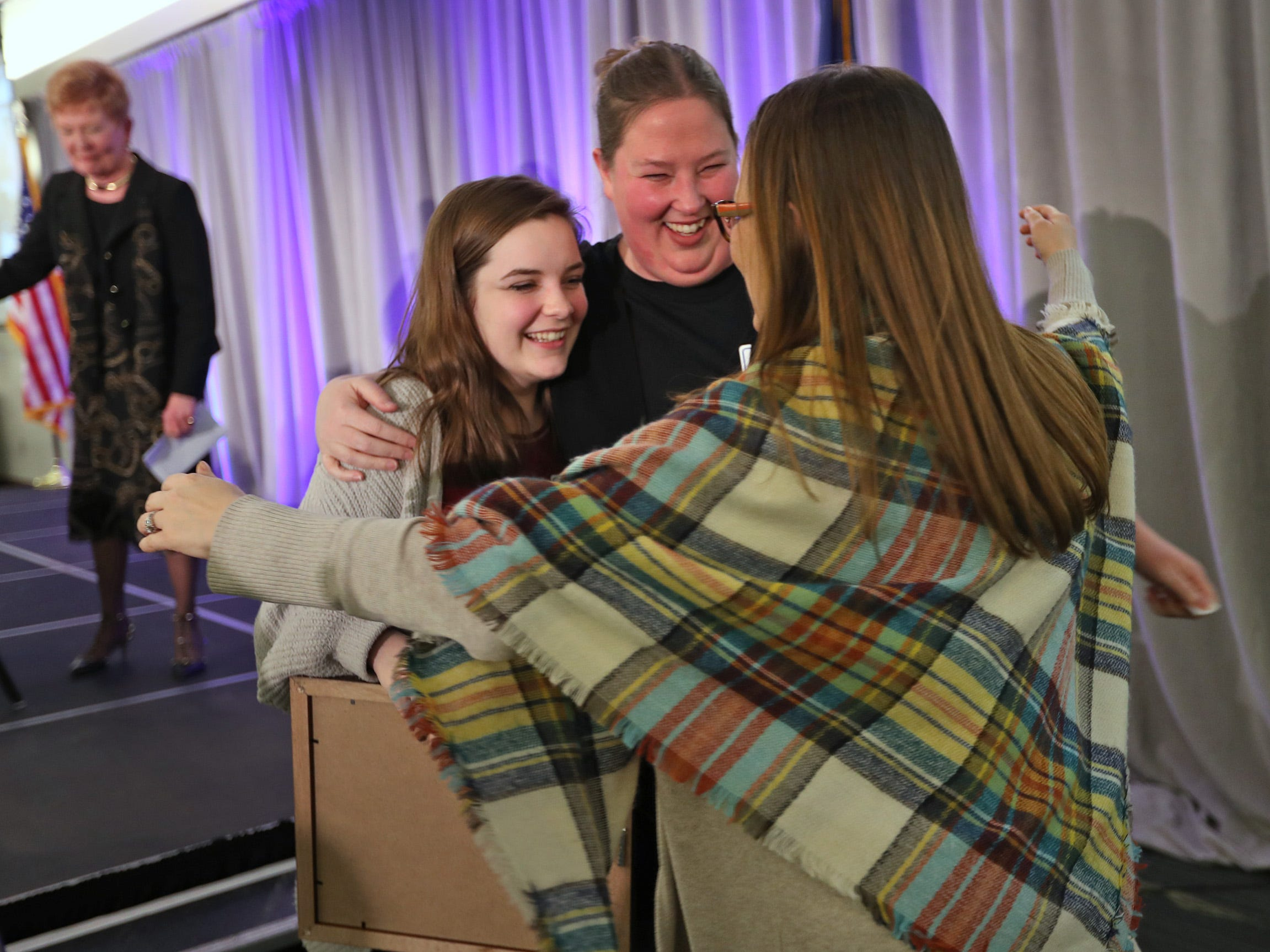Perry Meridian High School student Jordyn Sloan, from left, gets hugs from her teachers Jacqui Sheehan and Jessica Hunter after Danielle received her 2nd Place Scholarship award at the 44th Annual Abe Lincoln Awards Program, Friday, Feb. 8, 2019. The Kiwanis Club of Indianapolis program was held at Ivy Tech Community College.  20 high school student were honored at the annual event which celebrates overcoming adversity in life to succeed. Four of the 20 students received scholarships.