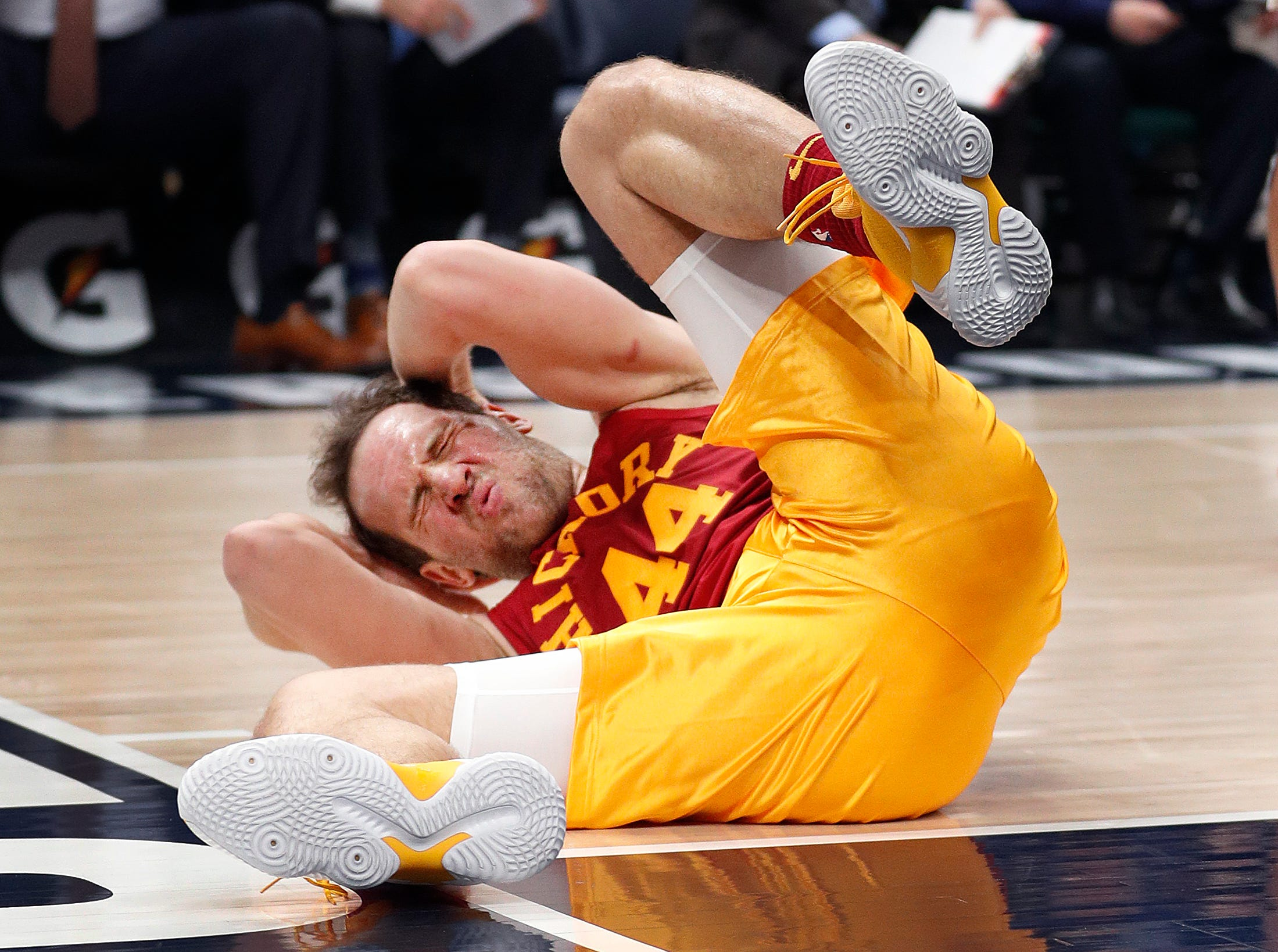 Indiana Pacers forward Bojan Bogdanovic (44) holds his head after falling to the court after he was fouled by LA Clippers forward Montrezl Harrell (5) in the first half of their game at Bankers Life Fieldhouse on Thursday, Feb. 7, 2019.