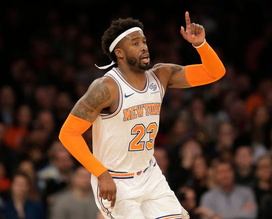 New York Knicks' Wesley Matthews reacts during the first half of an NBA basketball game against the Memphis Grizzlies.
