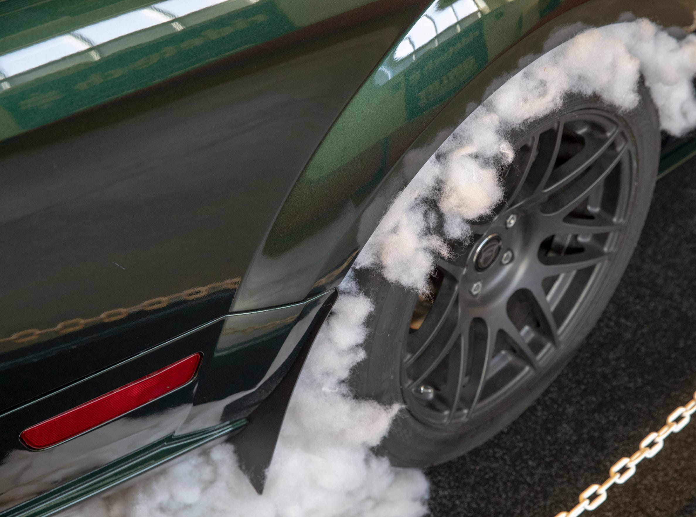 Bunting in the wheel wheels of a car to depict a smoking and screeching tire, at World of Wheels at the Indiana State Fairgrounds, Indianapolis, Friday, Feb. 8, 2019. The event runs through the weekend and features four big rooms of stock and heavily customized cars.