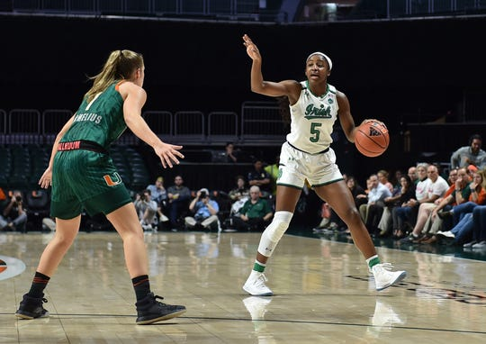 Feb 7, 2019; Coral Gables, FL, USA; Notre Dame Fighting Irish guard Jackie Young (5) dribbles the ball against Miami Hurricanes guard Laura Cornelius (1) at Watsco Center.