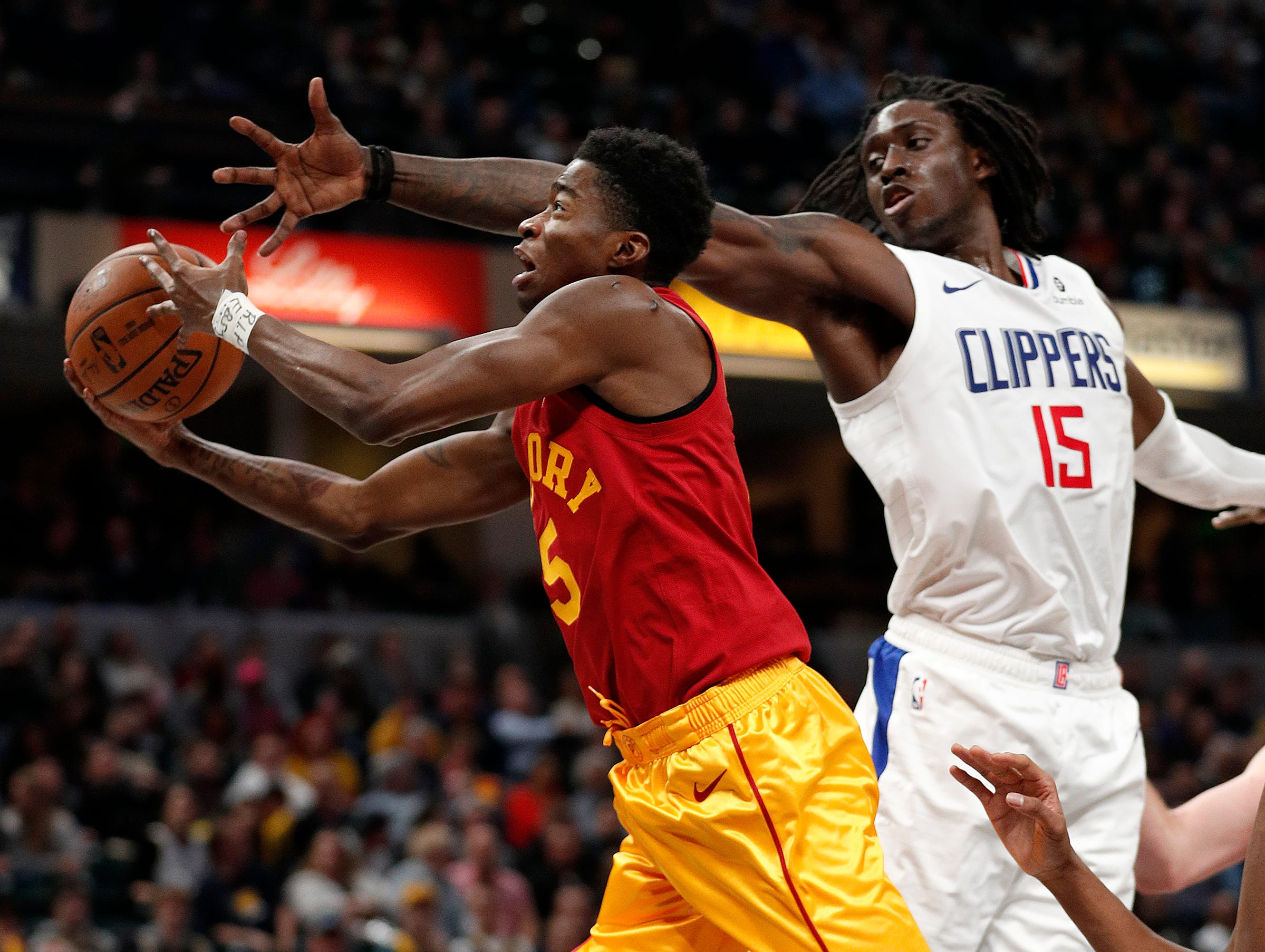Indiana Pacers guard Edmond Sumner (5) drives by LA Clippers forward Johnathan Motley (15) in the second half of their game at Bankers Life Fieldhouse on Thursday, Feb. 7, 2019.