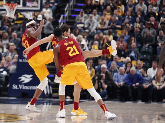 Indiana Pacers center Myles Turner (33) and  Bojan Bogdanovic (44) kick at the bat that flew around the court for the second time in their game against the LA Clippers  at Bankers Life Fieldhouse on Thursday, Feb. 7, 2019.
