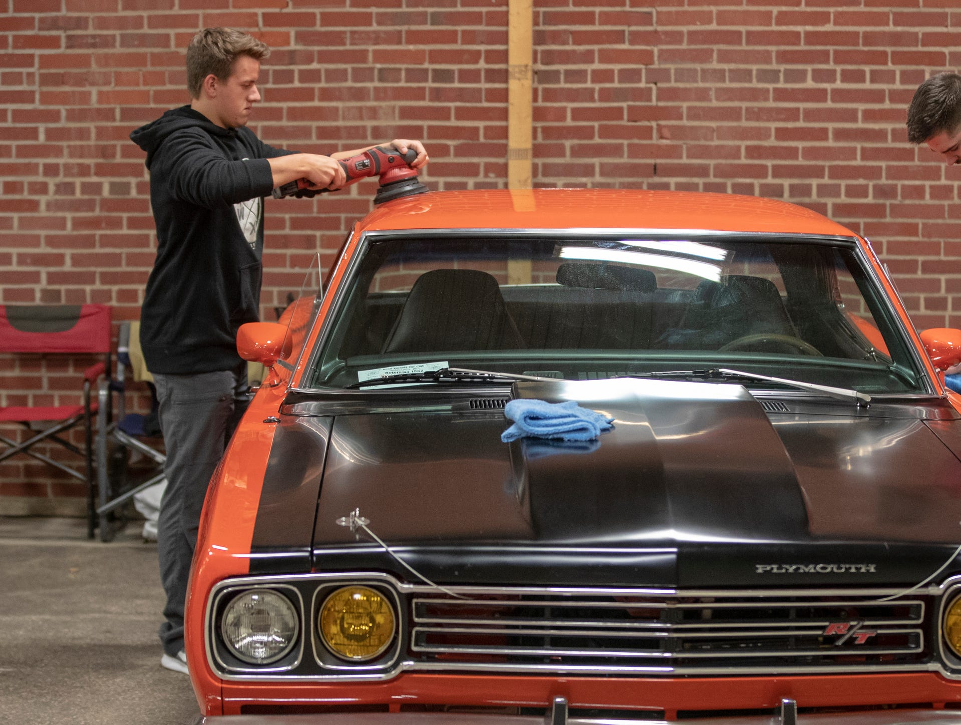 Austin Osborn (left), Kokomo, and Jordan Miller, Logansport, work on polishing up a 1969 Plymouth Satellite, at World of Wheels at the Indiana State Fairgrounds, Indianapolis, Friday, Feb. 8, 2019. The event runs through the weekend and features four big rooms of stock and heavily customized cars.