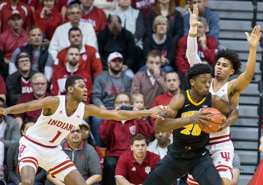 Hawkeyes forward Tyler Cook (25) looks to shoot the ball while Indiana Hoosiers forward Justin Smith (3) defends in the first half at Assembly Hall.