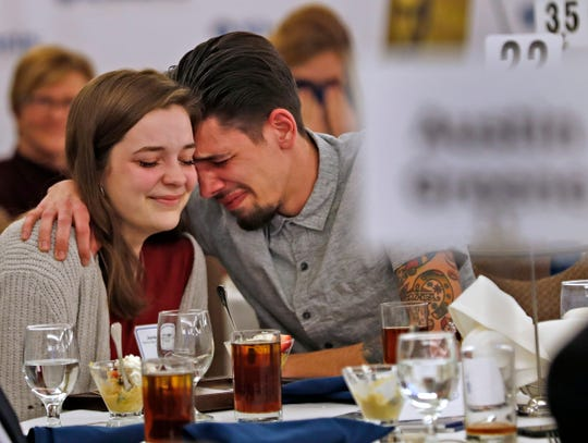 Perry Meridian High School student Jordyn Sloan, left, gets a proud and emotional hug from her brother, Shaun Sloan II, as it is announced that she is awarded the 1st Place Scholarship award at the 44th Annual Abe Lincoln Awards Program, Friday, Feb. 8, 2019. The Kiwanis Club of Indianapolis program was held at Ivy Tech Community College. 20 high school student were honored at the annual event which celebrates overcoming adversity in life to succeed.