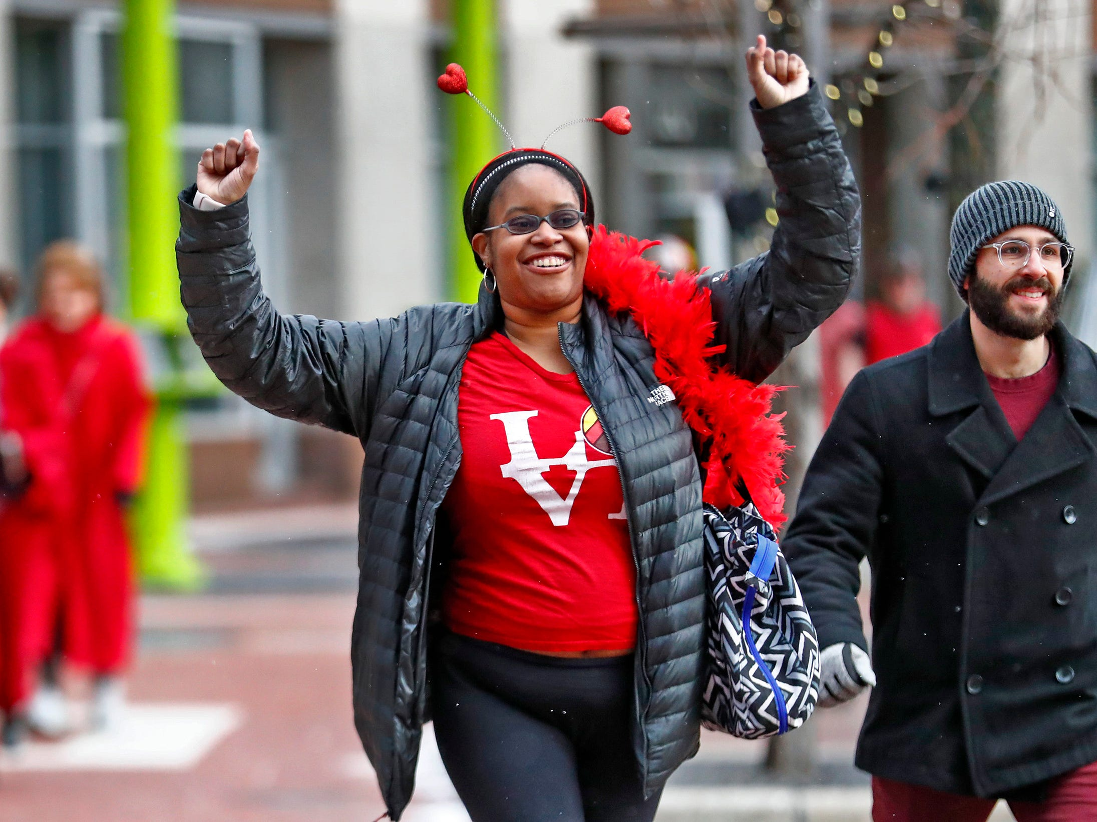 Renee Larson, center, and others have fun with a brisk run and dash around Monument Circle for the Red Dress Dash, Friday, Feb. 8, 2019.  The American Heart Association put on the seventh annual event to support women's heart health.  The event raises awareness for the American Heart Association's Go Red For Women movement.  Heart disease is the leading cause of death among women.