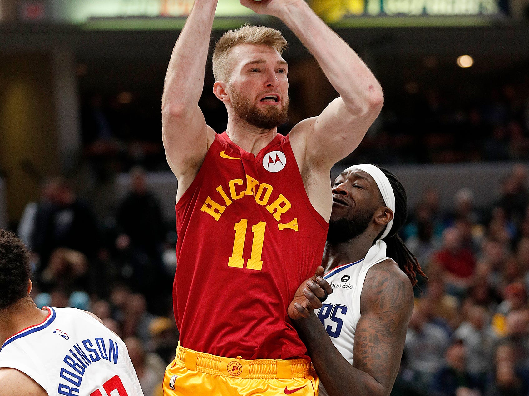 Indiana Pacers forward Domantas Sabonis (11) passes the ball by LA Clippers forward Montrezl Harrell (5) in the second half of their game at Bankers Life Fieldhouse on Thursday, Feb. 7, 2019.
