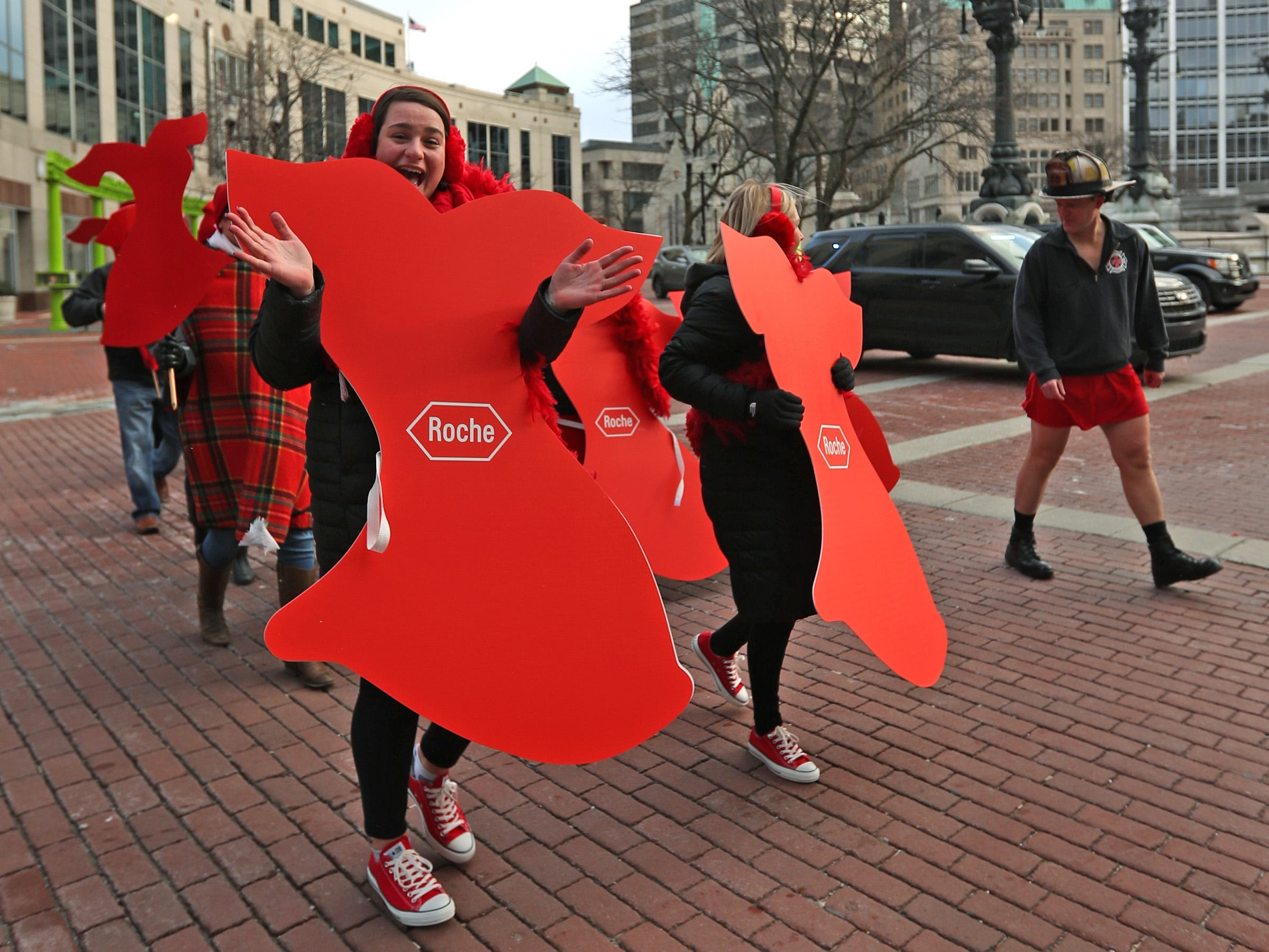 Maggie Sullivan, left, with Roche, joins others in red during a brisk walk around Monument Circle for the Red Dress Dash, Friday, Feb. 8, 2019.  The American Heart Association put on the seventh annual event to support women's heart health.  The event raises awareness for the American Heart Association's Go Red For Women movement.  Heart disease is the leading cause of death among women.
