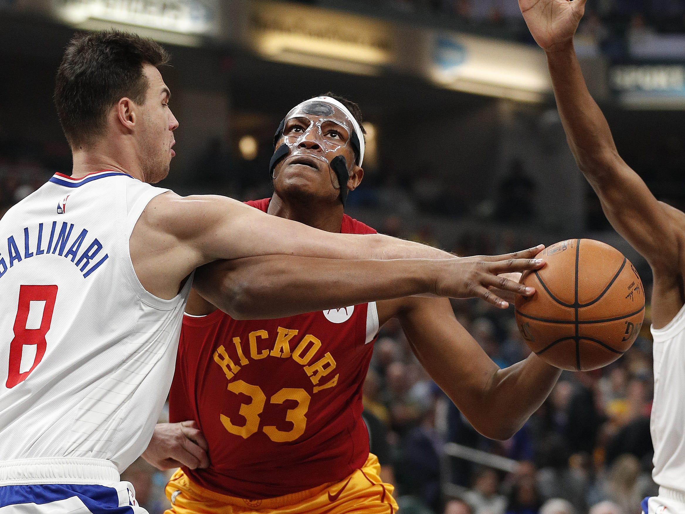 Indiana Pacers center Myles Turner (33)LA Clippers forward Danilo Gallinari (8)  is fouled by in the first half of their game at Bankers Life Fieldhouse on Thursday, Feb. 7, 2019.
