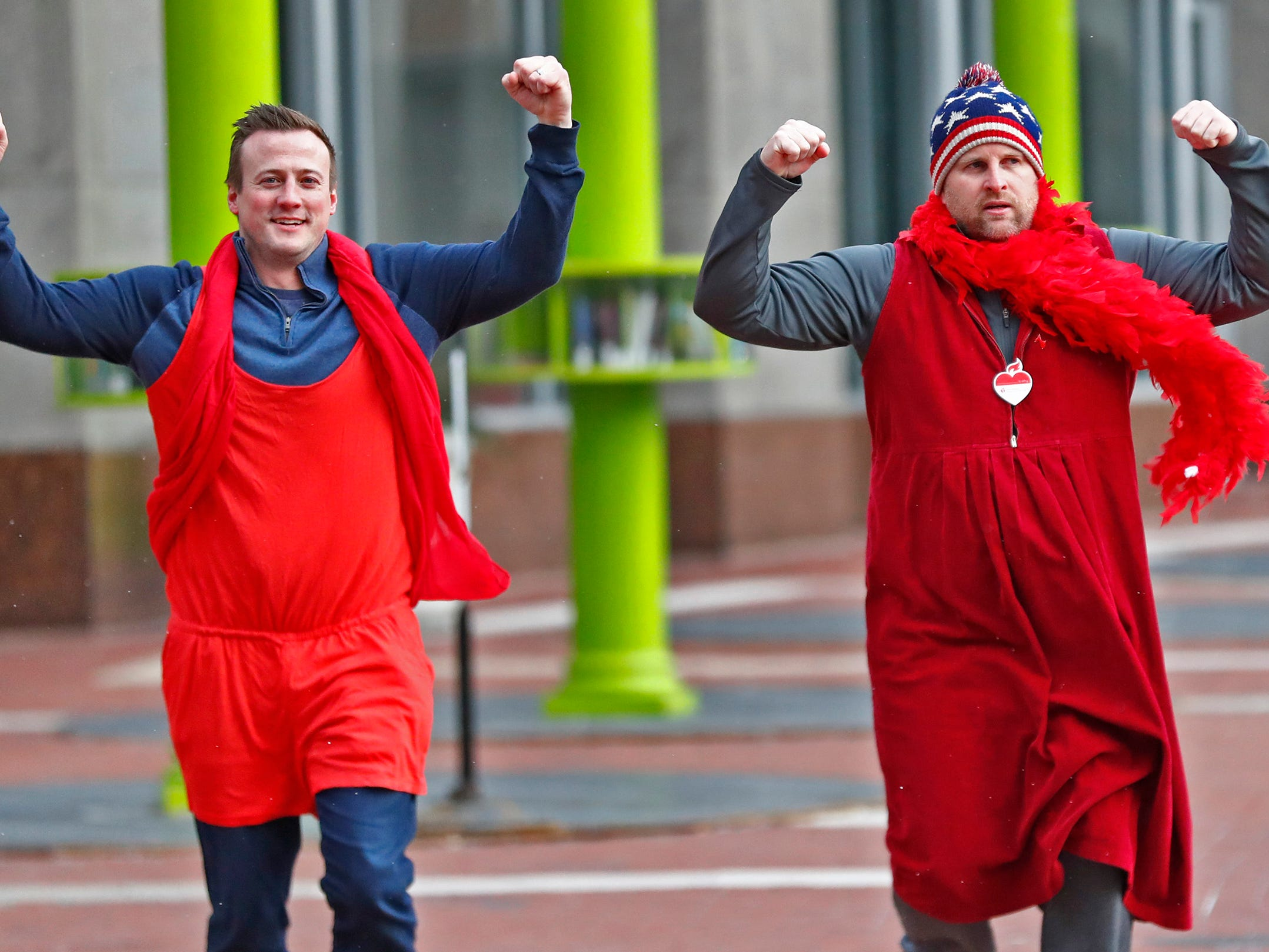 Patrick Triest, left, and Bryan Hohne, with J.D. Byrider, wear red as they dash around Monument Circle for the Red Dress Dash, Friday, Feb. 8, 2019.  The American Heart Association put on the seventh annual event to support women's heart health.  The event raises awareness for the American Heart Association's Go Red For Women movement.  Heart disease is the leading cause of death among women.