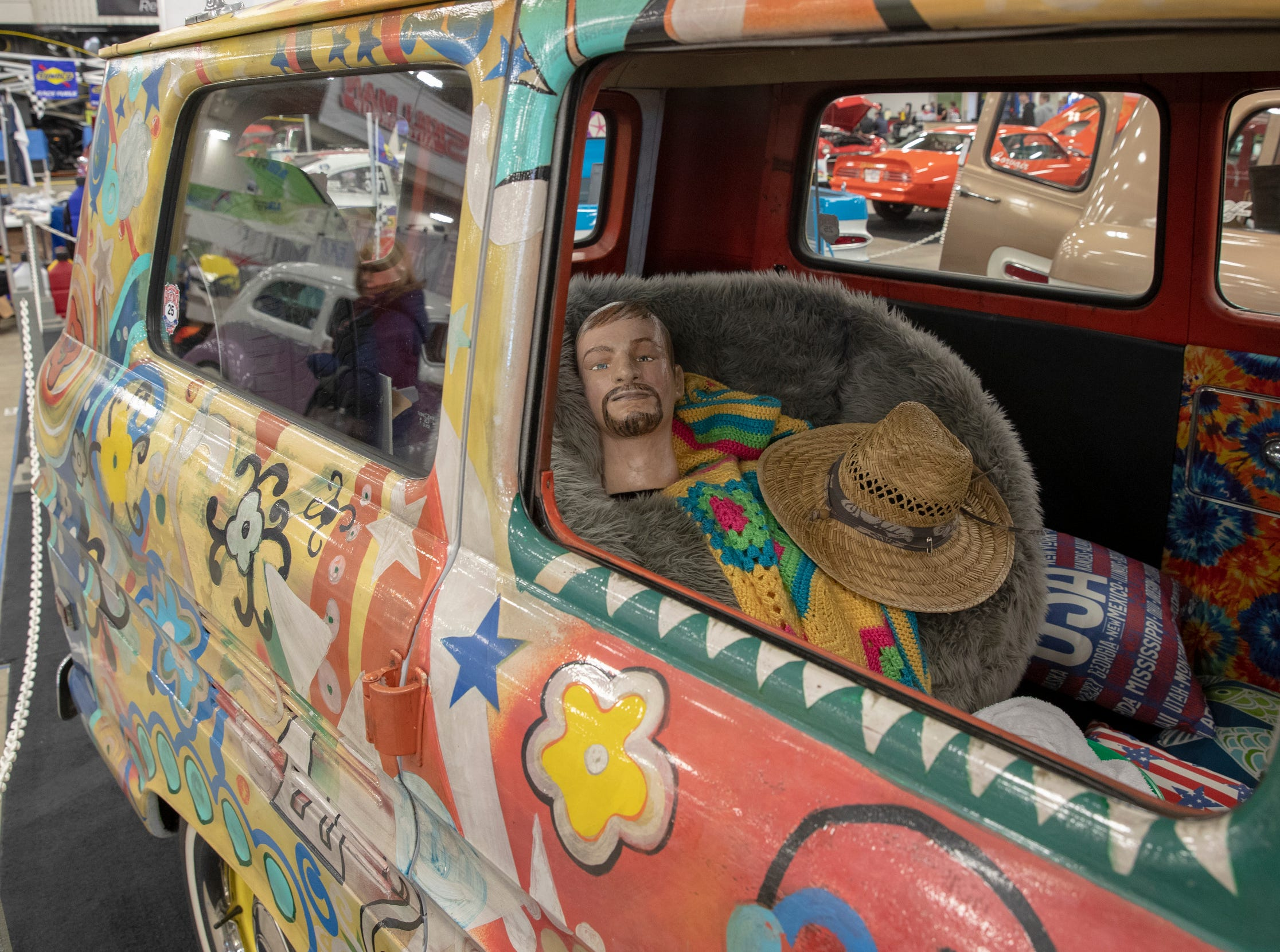 A 1962 Chevy Corvair Greenbrier Van, complete with a mannequin sitting inside, at World of Wheels at the Indiana State Fairgrounds, Indianapolis, Friday, Feb. 8, 2019. The event runs through the weekend and features four big rooms of stock and heavily customized cars.