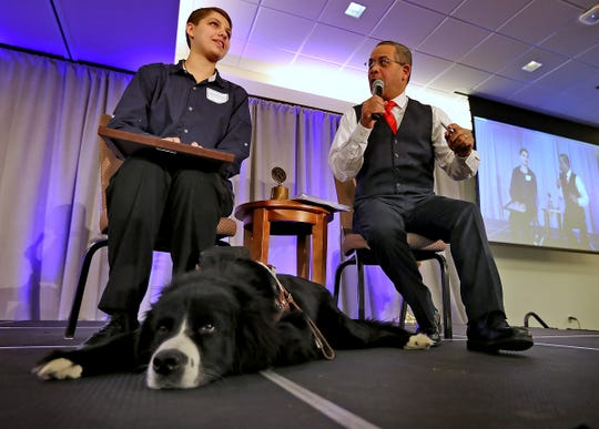 Indiana School for the Blind & Visually Impaired student Marie Villaneda, left, sitting with her guide dog Bear, is interviewed by Rafael Sanchez after being presented the 3rd Place Scholarship award at the 44th Annual Abe Lincoln Awards Program on Friday, Feb. 8, 2019.