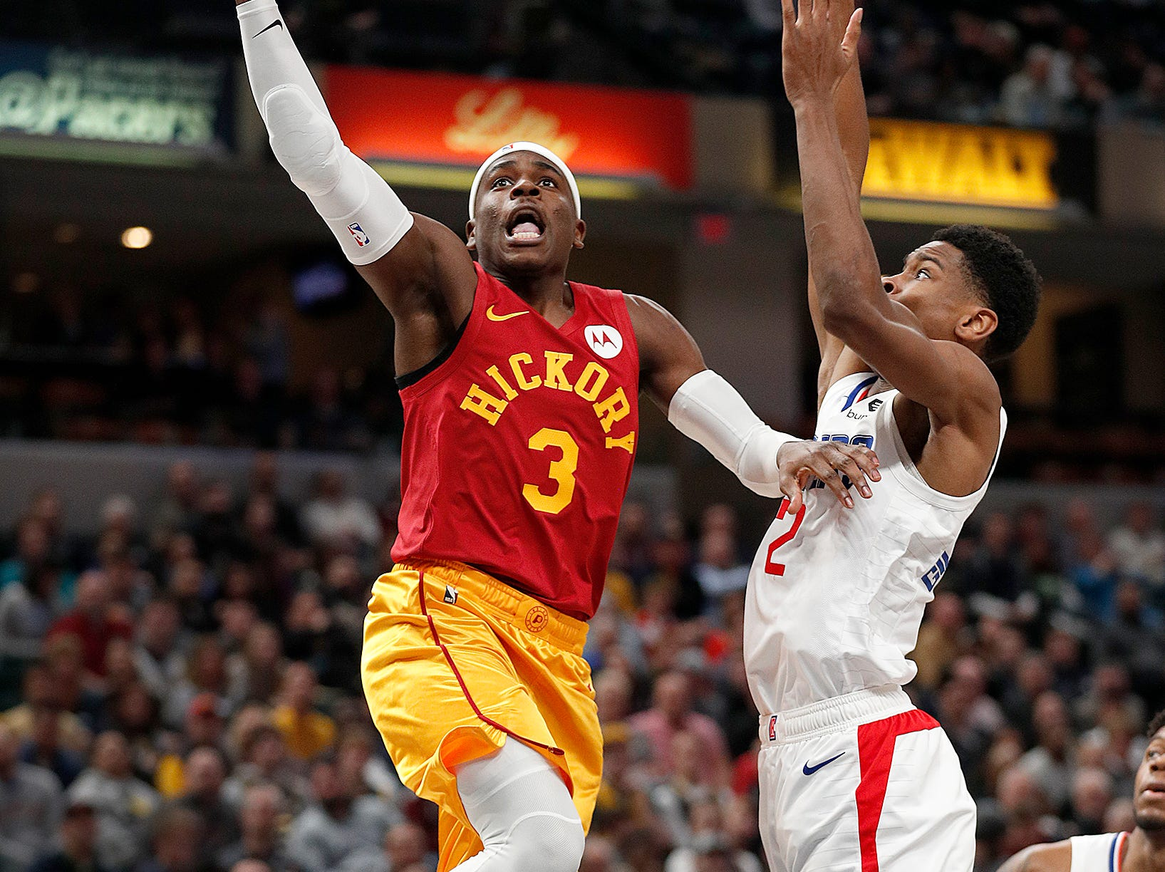 Indiana Pacers guard Aaron Holiday (3) drives on LA Clippers guard Shai Gilgeous-Alexander (2) in the second half of their game at Bankers Life Fieldhouse on Thursday, Feb. 7, 2019.