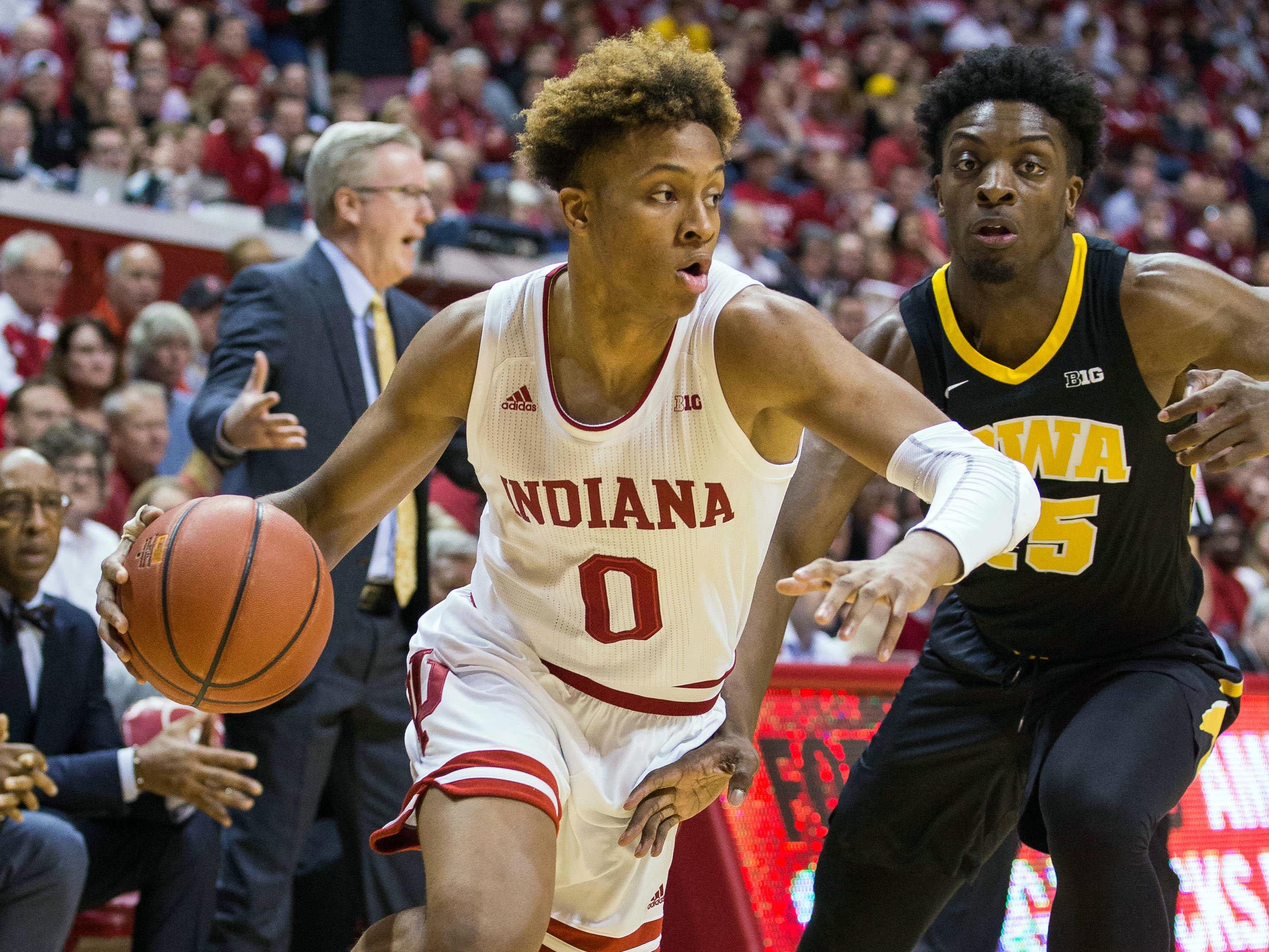 Feb 7, 2019; Bloomington, IN, USA; Indiana Hoosiers guard Romeo Langford (0) dribbles the ball around Iowa Hawkeyes forward Tyler Cook (25) in the first half at Assembly Hall.