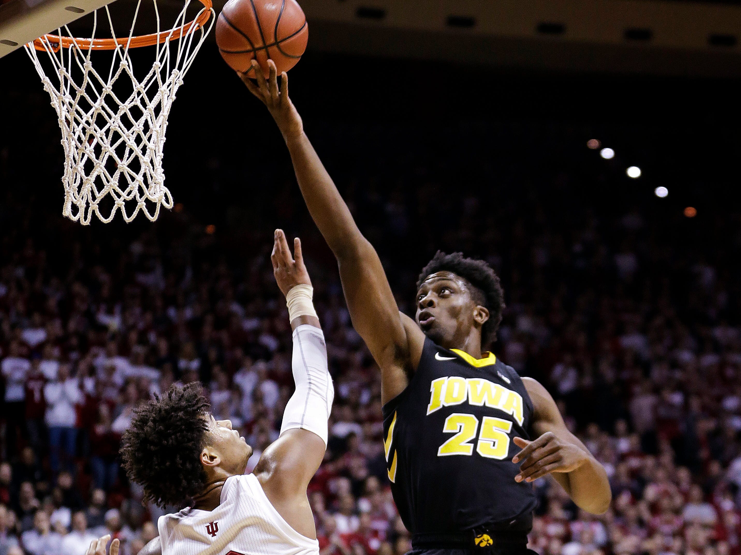Iowa forward Tyler Cook (25) shoots over Indiana forward Justin Smith (3) during the first half of an NCAA college basketball game in Bloomington, Ind., Thursday, Feb. 7, 2019.
