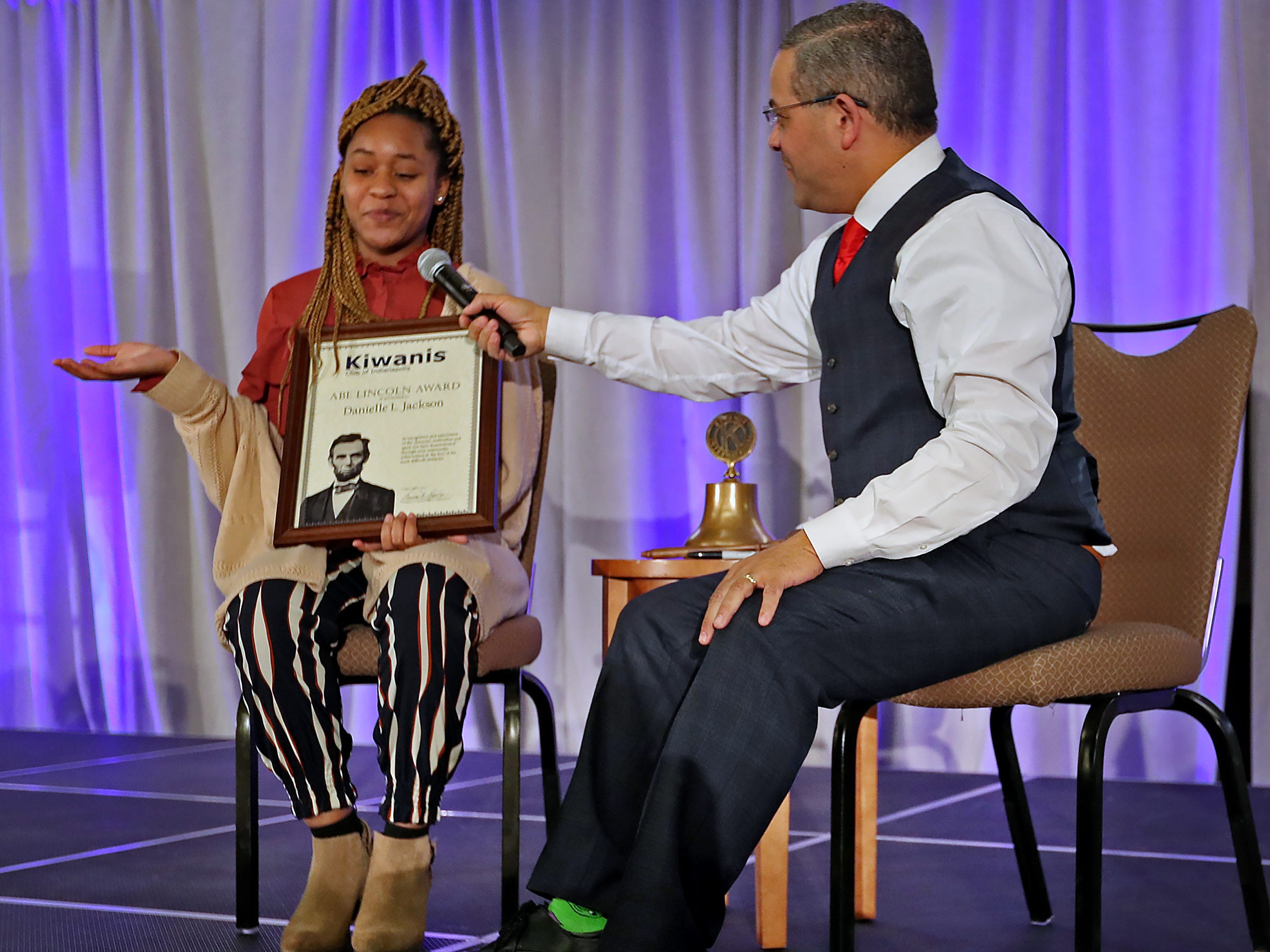 Pike High School student Danielle Jackson, left, is interviewed by Rafael Sanchez after receiving her 2nd Place Scholarship award at the 44th Annual Abe Lincoln Awards Program, Friday, Feb. 8, 2019. The Kiwanis Club of Indianapolis program was held at Ivy Tech Community College.  20 high school student were honored at the annual event which celebrates overcoming adversity in life to succeed. Four of the 20 students received scholarships.
