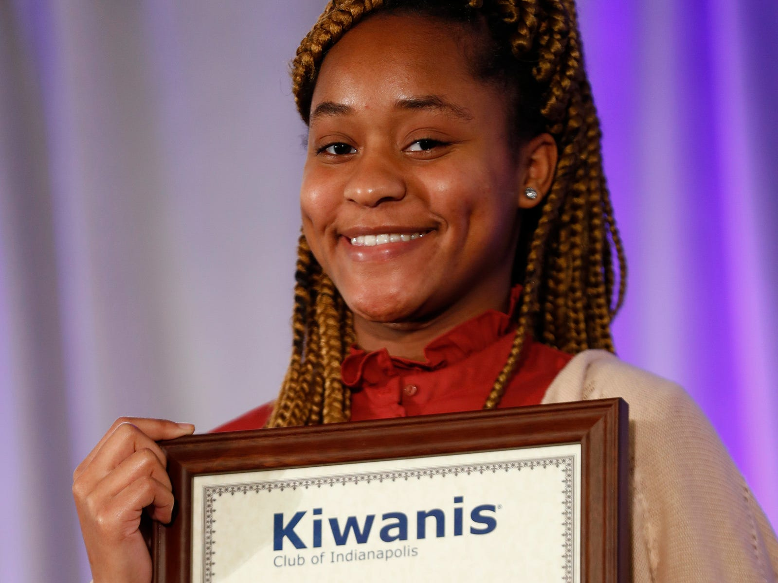 Pike High School student Danielle Jackson smiles after receiving her 2nd Place Scholarship award at the 44th Annual Abe Lincoln Awards Program, Friday, Feb. 8, 2019. The Kiwanis Club of Indianapolis program was held at Ivy Tech Community College.  20 high school student were honored at the annual event which celebrates overcoming adversity in life to succeed. Four of the 20 students received scholarships.