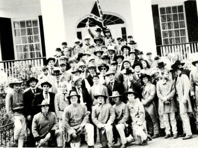 Members of a fraternity pose for a photo wearing Confederate army garb in the 1990s.