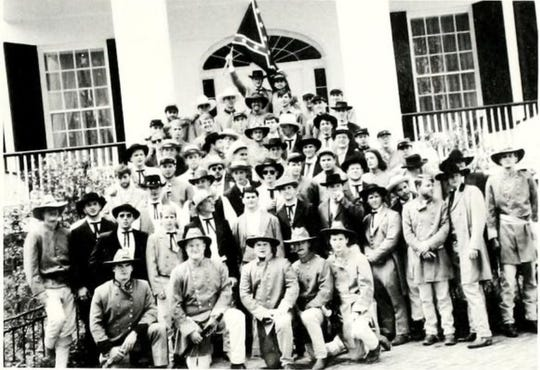 Members of the Kappa Alpha Fraternity pose for a photo wearing Confederate army garb. This photo was in the 1994-1995 yearbook of Millsaps College.