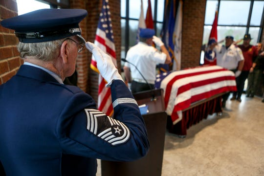 Honor Guard Chief Spurgeon J Smith salutes the casket of Sgt. Mary Nolen during a funeral for Sgt. Nolen, a military veteran with no known family at Tennessee State Veterans Cemetery in Parkers Crossroads, Tenn., on Thursday, Feb. 7, 2019.