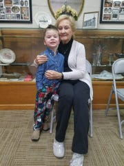 One of the youngest members of the Aldersgate congregation, 4-year-old Ace Wyatt, takes a picture with Patty Simmons, one of the longest-tenured members of the church.