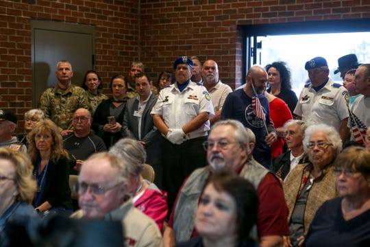 Attendees fill the small chapel to the point where it is standing room only during a funeral for Sgt. Mary Nolen, a military veteran with no known family at Tennessee State Veterans Cemetery in Parkers Crossroads, Tenn., on Thursday, Feb. 7, 2019.