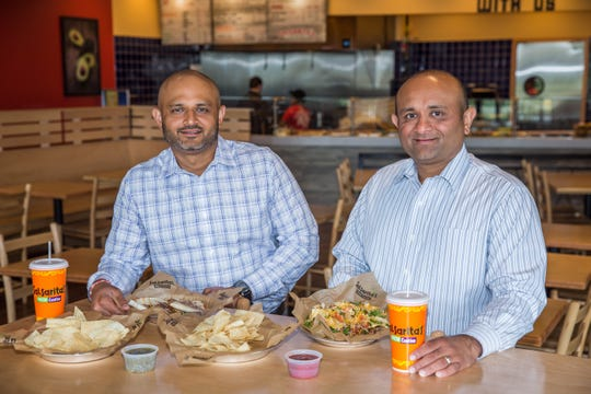 Since 2004,  brothers JT, left, and HP Patel have owned and operated LAXMI Ventures, which will now open its 11th Salsarita's Fresh Mexican Grill in Knoxville.