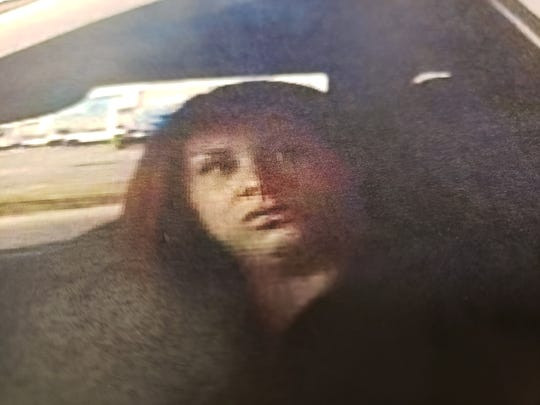 The FBI is asking for the public's assistance identifying and locating a woman suspected in a car robbery in which thousands of dollars were stolen using stolen checks and a stolen bank card.