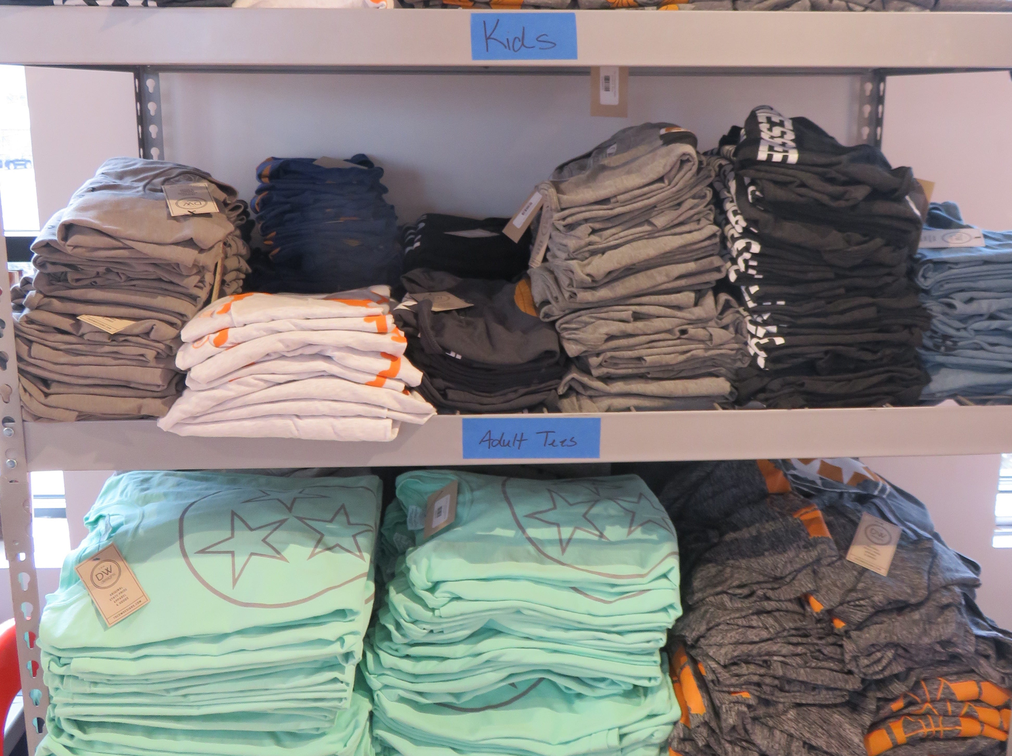 T-shirts sit in storage on second floor