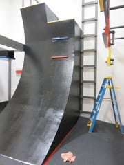 "Curved or ""warped"" wall is a focal point of Central Baptist Church of Bearden's new Ninja Gym."