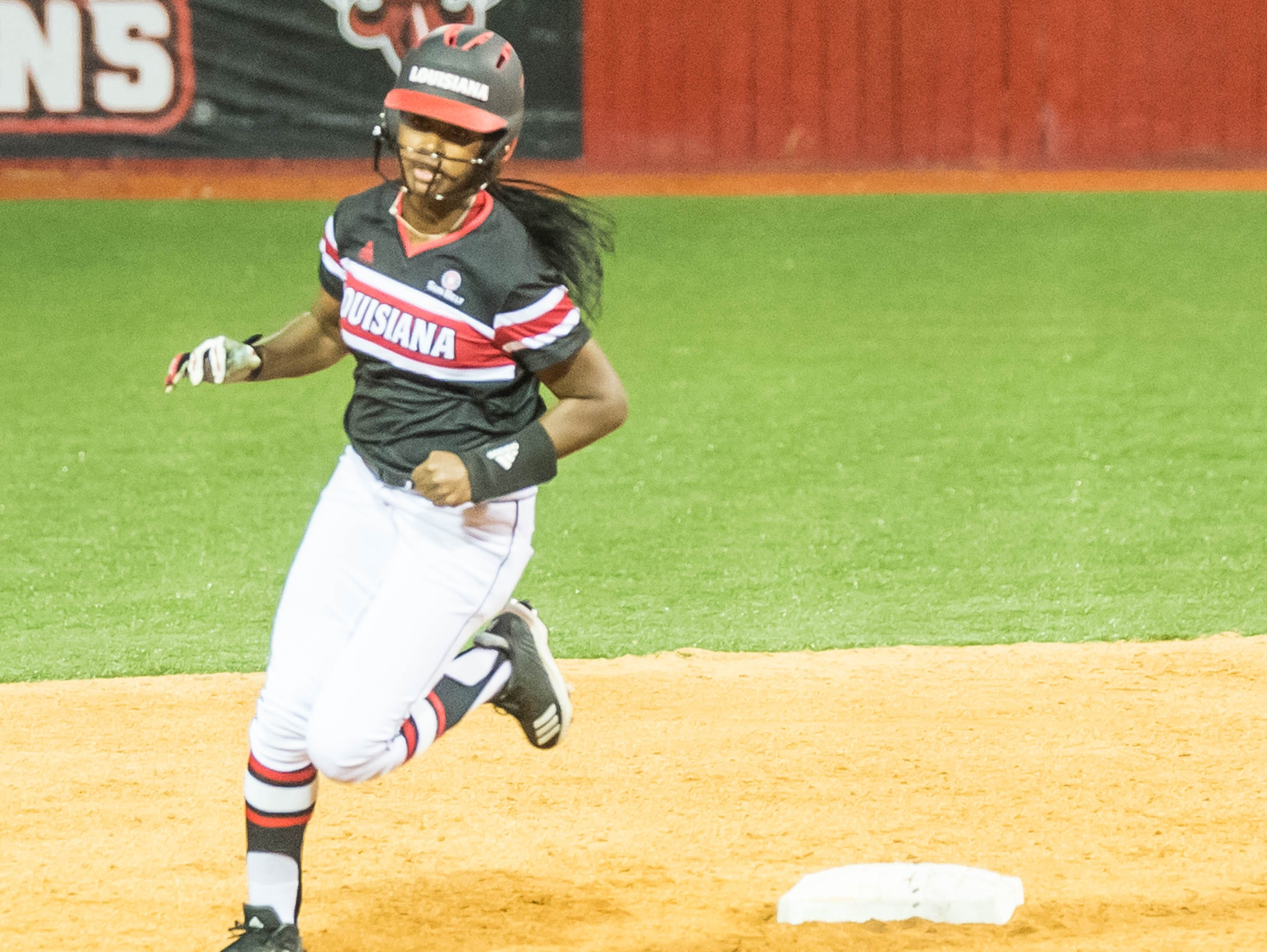 UL's Raina O'Neal rounds the bases after hitting the Ragin' Cajuns first home run of the season as the Ragin' Cajuns play Fordham in the opening game of the 2019 softball season at Lamson Park on Thursday, Feb. 7, 2019.
