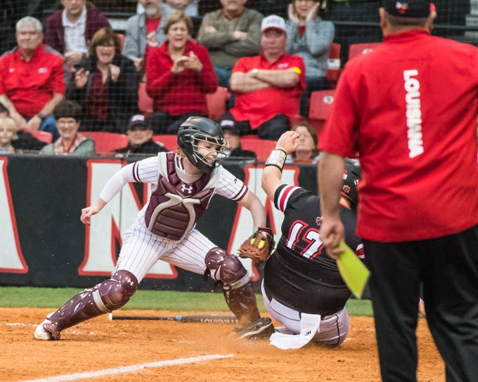 UL's Bailey Curry (17) is thrown out at home plate trying to score as the Ragin' Cajuns play Fordham in the opening game of the 2019 softball season at Lamson Park on Thursday, Feb. 7, 2019.
