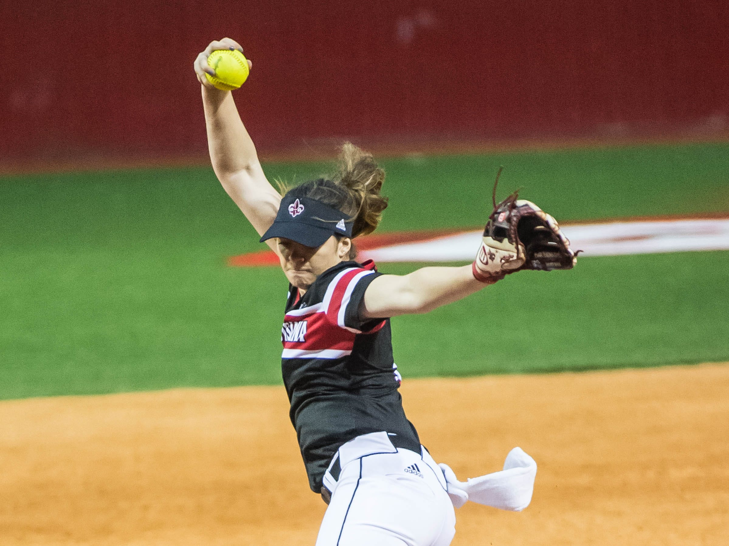 UL pitcher Summer Ellyson (9) has 16 strike outs in the Ragin' Cajuns'  opening game of the 2019 softball season against Fordham at Lamson Park on Thursday, Feb. 7, 2019.