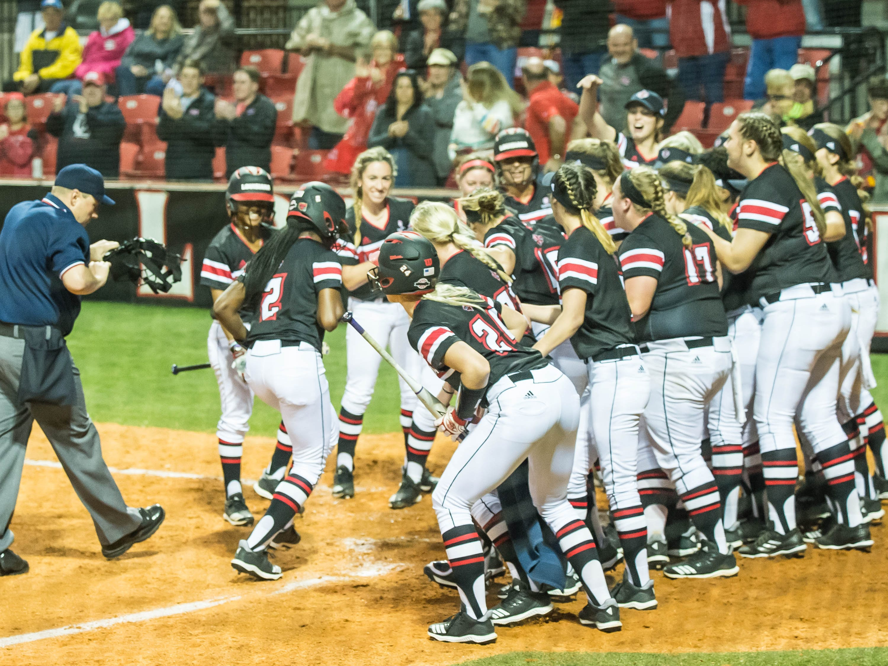 The UL Ragin' Cajuns welcome Raina O'Neal (2) back to home plate after hitting the Cajuns' first home run as the Ragin' Cajuns play Fordham in the opening game of the 2019 softball season at Lamson Park on Thursday, Feb. 7, 2019.