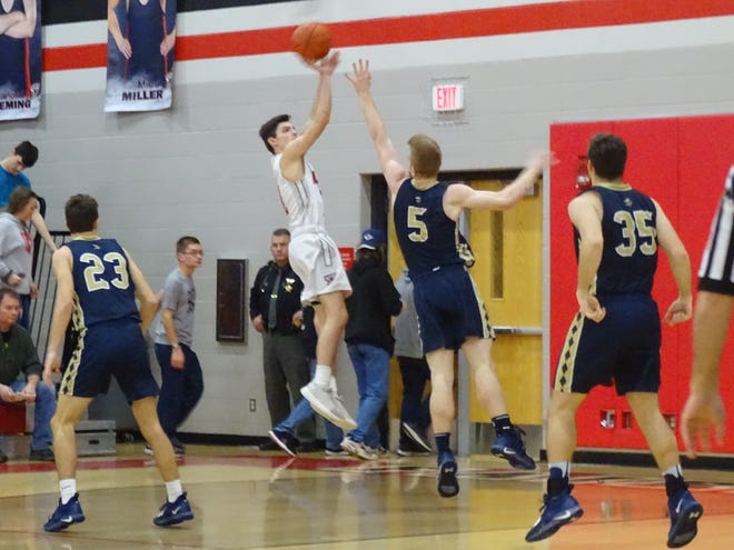 Fairfield Union's Evan Conley shoots the ball over Teays Valley's Max Young during the Falcons' 47-42 loss Thursday night.
