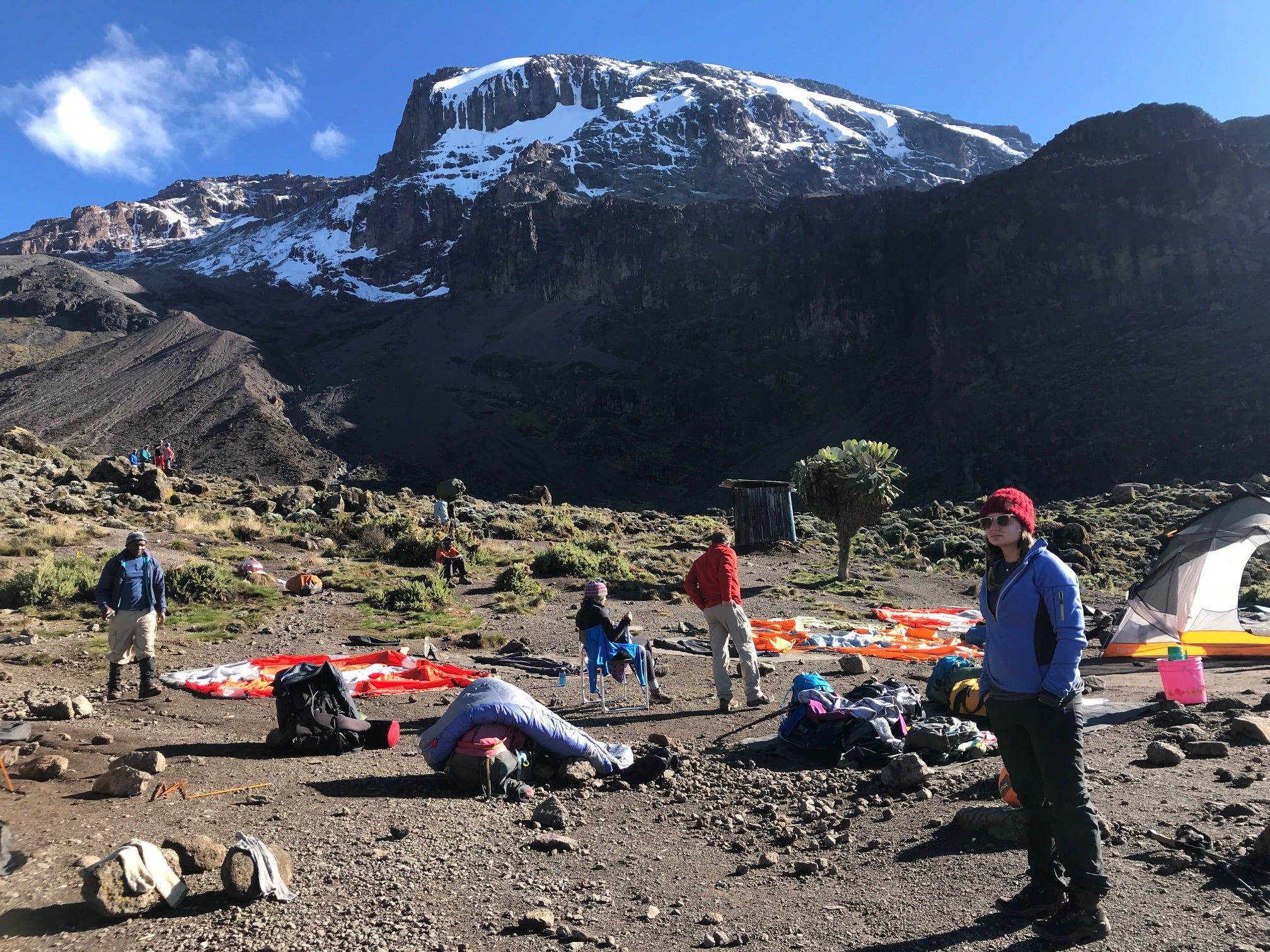 Jordan Grantz waits to begin trekking at Barranco Wall camp on Mount Kilimanjaro, Tanzania
