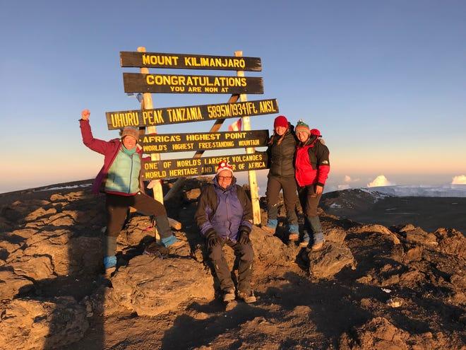 Kirby Adams, John Grantz, Jordan Grantz, Elliott Grantz at Uhuru Peak the summit of Mount Kilimanjaro, Tanzania