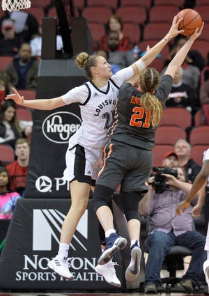 Louisville forward Kylee Shook (21) blocks the shot of Syracuse guard Emily Engstler (21) during the second half of an NCAA college basketball game in Louisville, Ky., Thursday, Feb. 7, 2019.