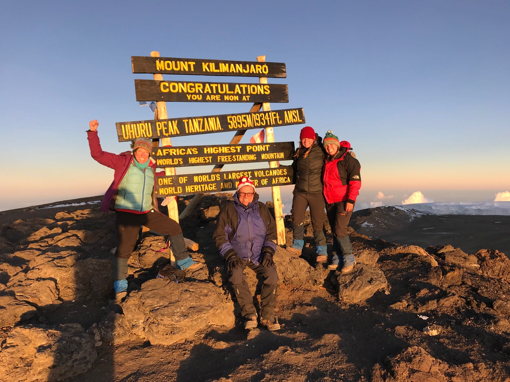 The summit of Mount Kilimanjaro, Tanzania. Kirby Adams, John Grantz, Jordan Grantz, Elliott Grantz